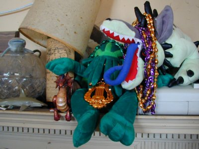Plush Cthulhu and Hound of Tindalos in Mardi Gras beads
